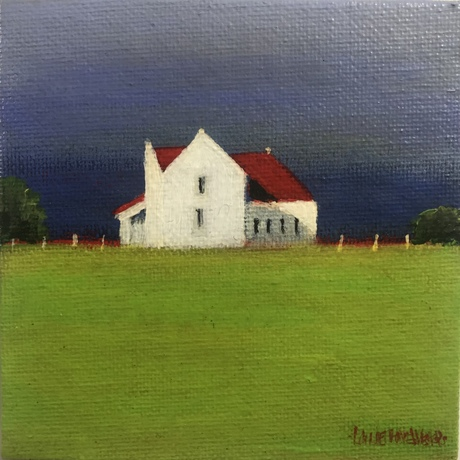 White house with red roof in a green meadow