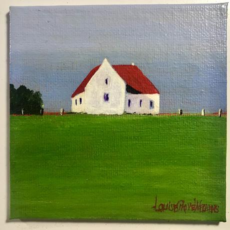 Farmhouse with red roof, in a green meadow