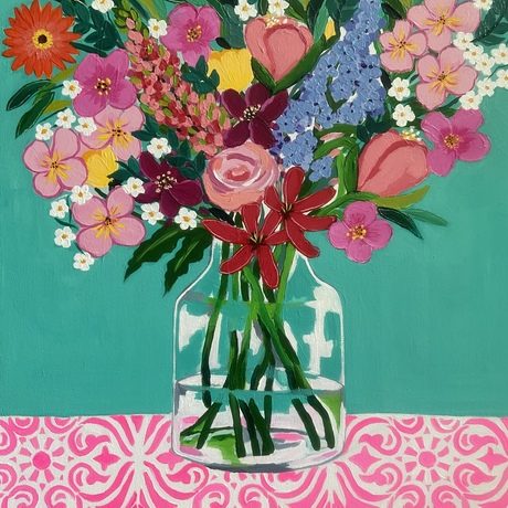 Flowers in jar with turquoise background on bright neon pink patterned tablecloth