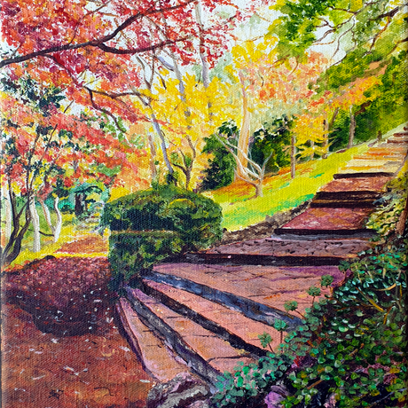 a small colourful landscape artwork following a garden path littered with fallen autumn foliage, with garden stairs leading to another spot, under a canopy of vibrant autumn colours as well as olive green.