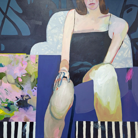 Woman seating on the armchair