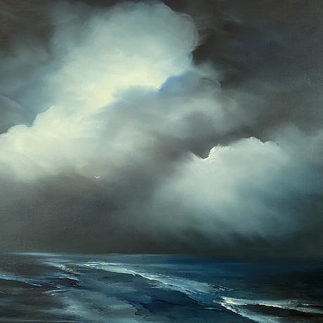Dark sky with lit clouds and sea