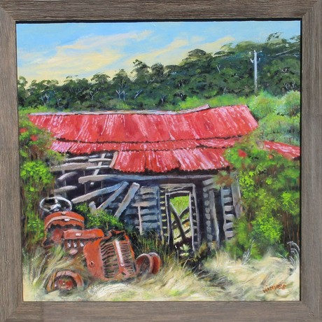 An old derelict farm house is shown with an aged red tractor slowly deteriorating in overgrown vegetation.