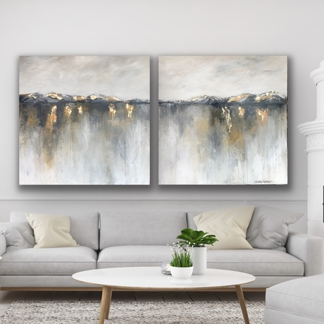 Black and grey hills above a gold grey mustard white water with moody cream beige sky
