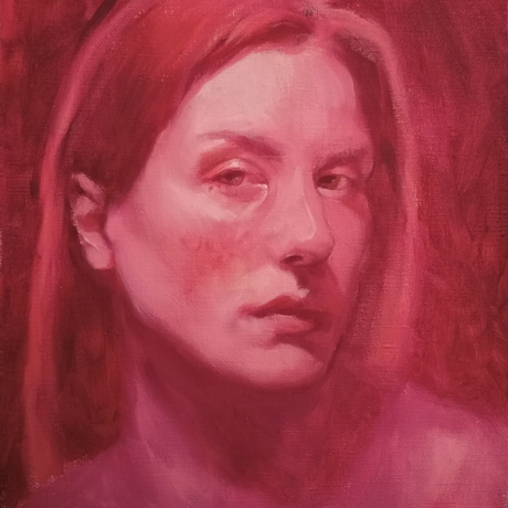 A woman with face titled to the side looking at the viewer painted in reds and pinks