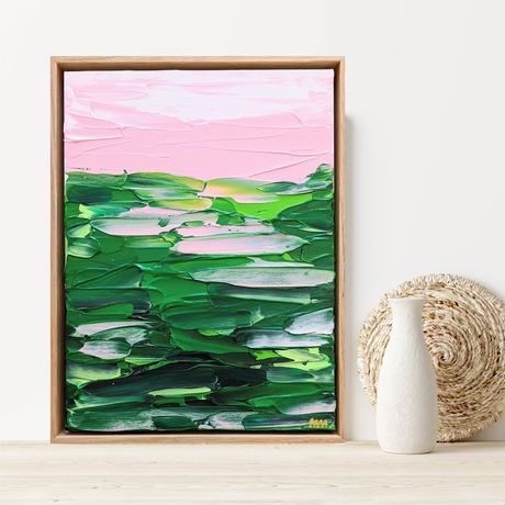 green textured abstract landscape artwork with pink accents framed in oak