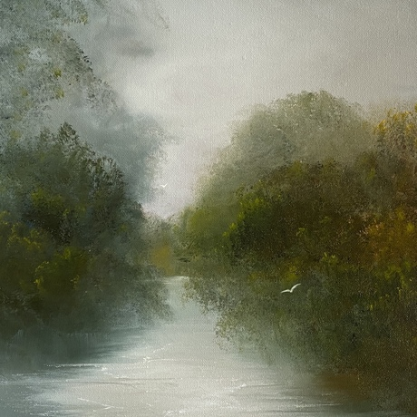 A river and trees in mist