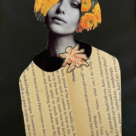 girls face with marigold flowers in her hair an angel brooch and aged book paper as her shirt