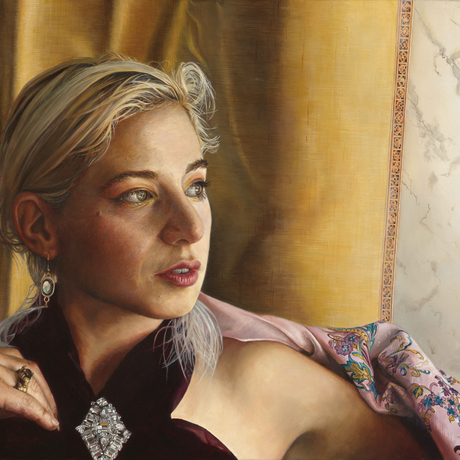 A canvas wider than than tall shows a blonde woman reclining languidly on a couch, opulently dressed in deep red velvet and extravagant jewellery. She has a pink satin brocaded jacket draped over one shoulder. Behind her is a white marble wall and a gold silk curtain.