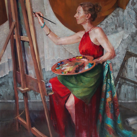 Artist painting in the studio with palette