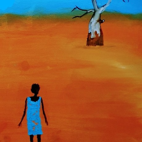 Girl standing alone in outback.