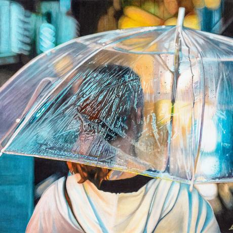 Woman under umbrella at night