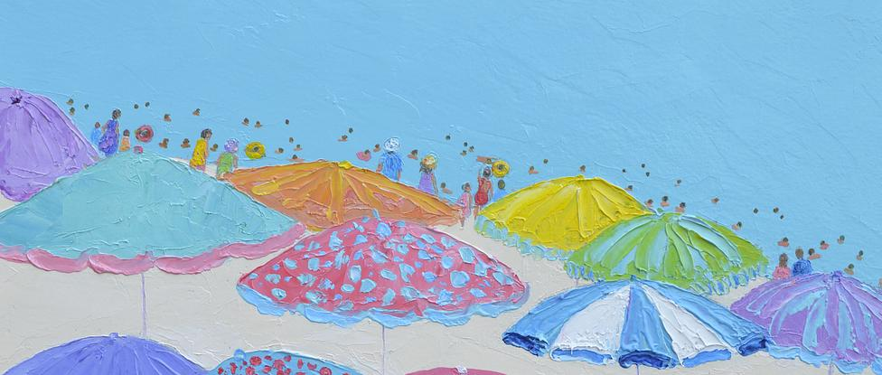 Colourful beach umbrellas with turquoise ocean.