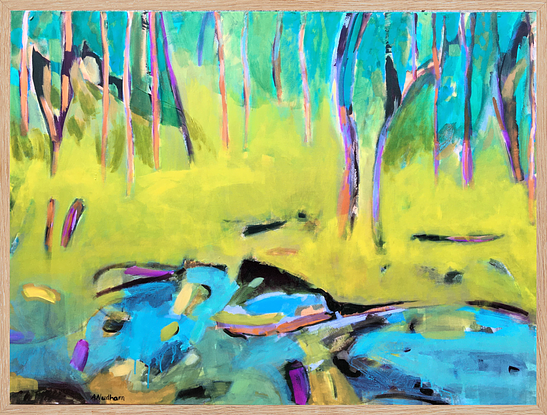 Australian bush landscape with yellow mid ground, colorful trees a creek with stones running in the foreground