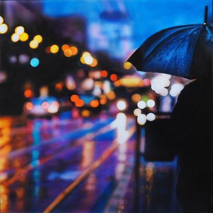 City lights reflected on wet street.
