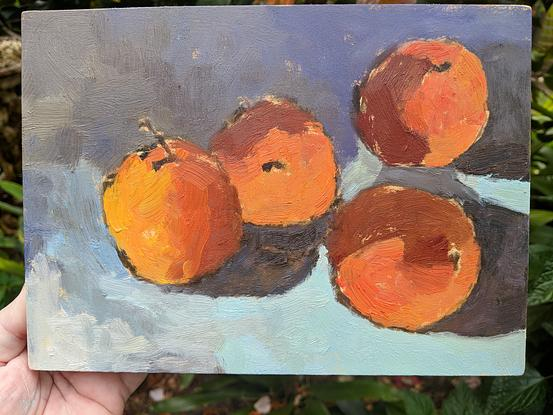 Oil painting of 4 oranges on table
