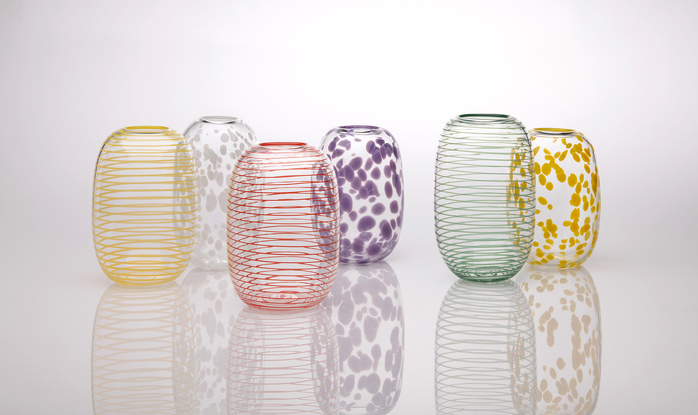 Tall, rounded clear glass vase with opaque yellow spots