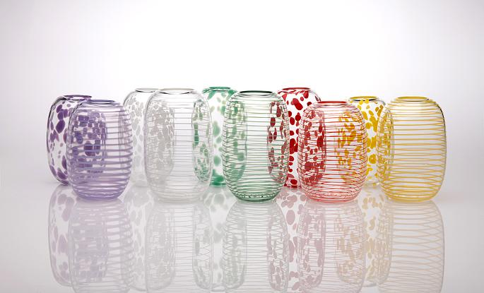 Tall, rounded clear glass vase with opaque red spots