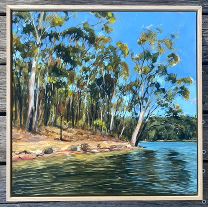 Golden light through gum trees  with water reflections