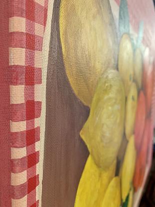 Lemon and Orange fruit box on gingham tablecloth