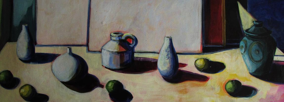 vessels and fruit placed in wide format with strong shadows