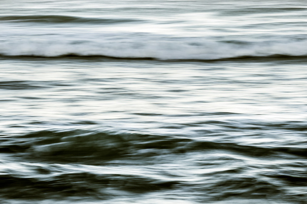 Abstract ocean scene of water to mimic long paint strokes.
